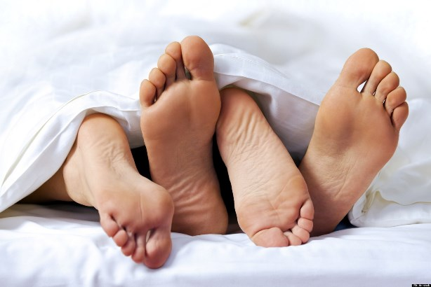 Close-up of the feet of a couple on the bed; Shutterstock ID 64226662; PO: aol; Job: production; Client: drone
